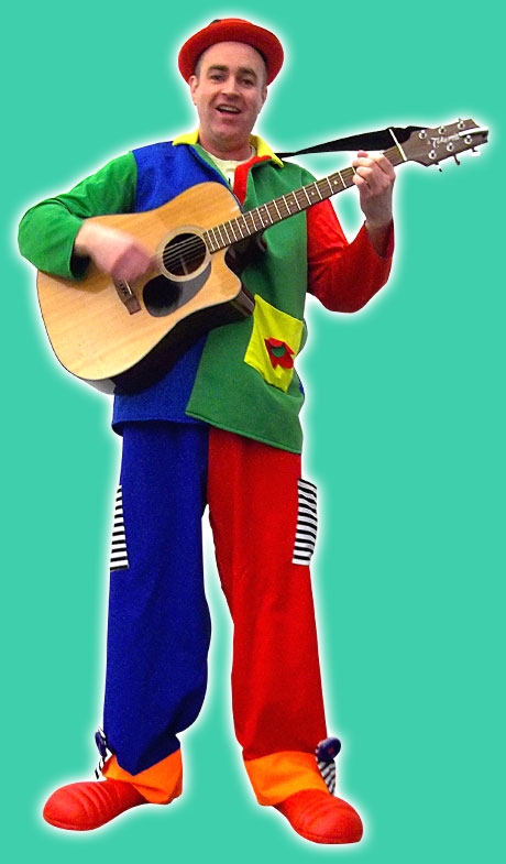 Adam Shrimpton the children's party musician entertainer holding a guitar in a colorful outfit