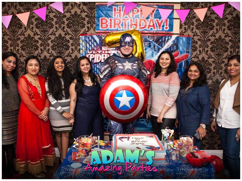 Captain America standing with Family at a birthday party